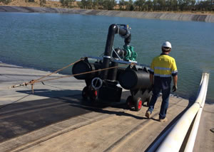 pump pontoon for lined dam installation